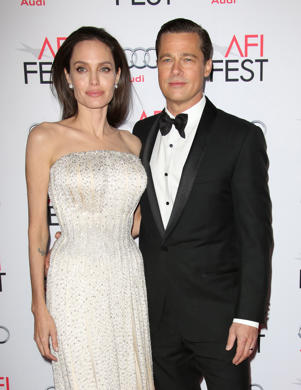 "Brad Pitt and woman posing for a picture: Angelina Jolie and Brad Pitt attend their ""By the Sea"" film premiere in Los Angeles on Nov. 5, 2015."