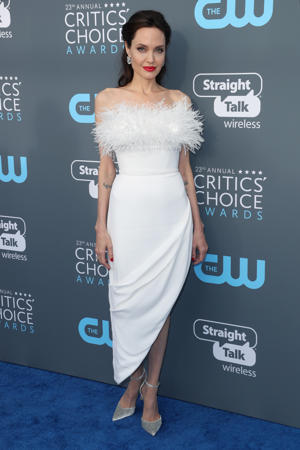 Angelina Jolie holding a sign: Angelina Jolie attends the Critics' Choice Awards in Los Angeles on Jan. 11, 2018.