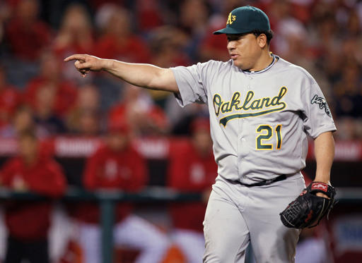 Slide 1 of 45: 2012: Oakland Athletics pitcher Bartolo Colon celebrates the last out against the Los Angeles Angels.