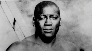 a person posing for the camera: Who is boxer Jack Johnson?