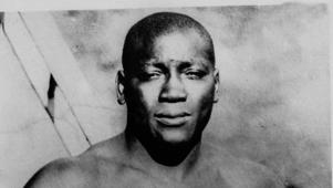 Jack Johnson posing for the camera: Trump pardons late boxing champ Jack Johnson