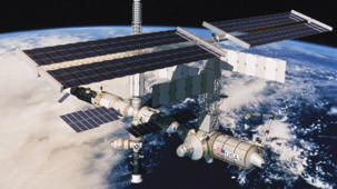 a satellite in space: Raw: Cargo ship docks with Space Station