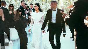 a group of people posing for the camera: Kim Kardashian & Kanye West Celebrate 4th Wedding Anniversary