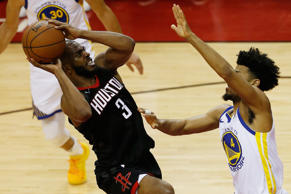 HOUSTON, TX - MAY 24:  Chris Paul #3 of the Houston Rockets goes up against Quinn Cook #4 of the Golden State Warriors in the fourth quarter of Game Five of the Western Conference Finals of the 2018 NBA Playoffs at Toyota Center on May 24, 2018 in Houston, Texas.  (Photo by Bob Levey/Getty Images)