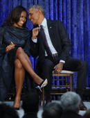 Former U.S. President Barack Obama sits with former first lady Michelle Obama prior to the the unveiling of their portraits at the Smithsonian's National Portrait Gallery in Washington, U.S., February 12, 2018. REUTERS/Jim Bourg
