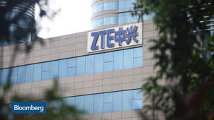 a sign on the side of a building: Inside the White House's ZTE Deal