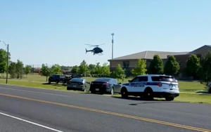 A helicopter lands near Noblesville West Middle School in Noblesville, Indiana, U.S., May 25, 2018 in this still image obtained from social media video. COURTESY CHRISTOPHER REILY/via REUTERS   ATTENTION EDITORS - THIS IMAGE HAS BEEN SUPPLIED BY A THIRD PARTY. MANDATORY CREDIT. NO RESALES. NO ARCHIVES - RC140F13F4A0