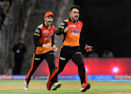 Rashid Khan celebrates after picking a wicket.