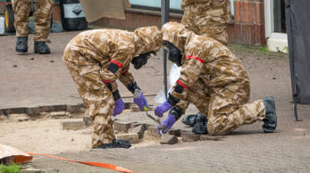 SALISBURY, ENGLAND - APRIL 25: Members of the military work in the Maltings shopping area, close to the bench where Russian former double agent Sergei Skripal and his daughter Yulia were found critically ill seven weeks ago, on April 25, 2018 in Salisbury, England. The area around the bench where the couple collapsed is one of nine sites to be cleaned in an operation that is likely to take several months. (Photo by Matt Cardy/Getty Images)