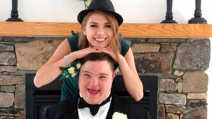 a girl posing for a picture: The unlikely story of how best friends became prom dates