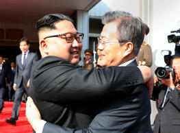 South Korean President Moon Jae-in bids fairwell to North Korean leader Kim Jong Un as he leaves after their summit at the truce village of Panmunjom, North Korea, in this handout picture provided by the Presidential Blue House on May 26, 2018.