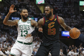 Cleveland Cavaliers' LeBron James (23) drives against Boston Celtics' Marcus Morris (13) during the first half of Game 6 of the NBA basketball Eastern Conference finals Friday, May 25, 2018, in Cleveland. (AP Photo/Ron Schwane)