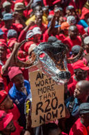 Thousands of workers take part in a national strike called by the country's second largest labour union (South African Federation of Trade Unions SAFTU) against a government proposed minimum wage on April 25, 2018 in Johannesburg.