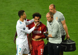 Cristiano Ronaldo of Real Madrid consoles Mohamed Salah of Liverpool as he leaves the pitch injured during the UEFA Champions League Final between Real Madrid and Liverpool at NSC Olimpiyskiy Stadium on May 26, 2018 in Kiev, Ukraine.