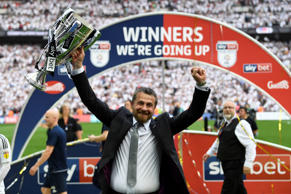 Fulham manager Slavisa Jokanovic celebrates promotion to the Premier League with the trophy