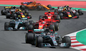 Mercedes' Lewis Hamilton leads Ferrari's Sebastian Vettel at the first corner during the race