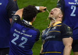 Cian Healy and Joey Carbery of Leinster celebrate following the European Rugby Champions Cup Final match between Leinster and Racing 92 at San Mames Stadium
