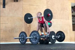 See if a man can lift 200 pounds with one of the barbells in his mouth