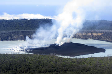 This Oct. 1, 2017, file photo provided by GeoHazards Division, Vanuatu Meteorological and GeoHazards Department, shows an aerial view of the volcanic cone that has formed in Lake Vui near the summit of Ambae Island, Vanuatu.