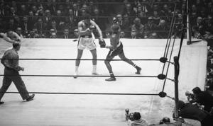 Cassius Clay ) and Doug Jones exchange blows during their heavyweight bout at Madison Square Garden, New York, New York, March 13, 1963.