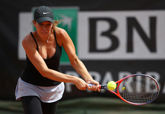 Slide 1 of 22: Danielle Collins of USA in action against Sorana Cirstea of Romania during day three of the Internazionali BNL d'Italia 2018 tennis at Foro Italico on May 15, 2018 in Rome, Italy.  (Photo by Julian Finney/Getty Images)
