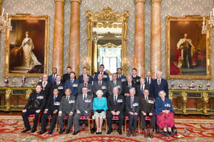 A group photo of holders of the Victoria and George Cross medals with the Queen (John Stillwell/PA)