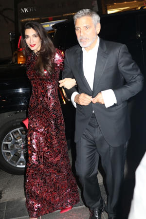 Amal Clooney et al. posing for a picture: George Clooney and Amal Clooney return to their hotel after the Met Gala in New York City on May 7, 2018. Pictured: George Clooney, Amal Clooney BACKGRID USA 8 MAY 2018 BYLINE MUST READ: BlayzenPhotos / BACKGRID USA: +1 310 798 9111 / usasales@backgrid.com UK: +44 208 344 2007 / uksales@backgrid.com *UK Clients - Pictures Containing Children Please Pixelate Face Prior To Publication*