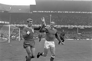 Two of England's World Cup winning team, Liverpool's Roger Hunt (l) and Everton's Ray Wilson (r), parade the World Cup around Goodison Park before the match   (Photo by PA Images via Getty Images)