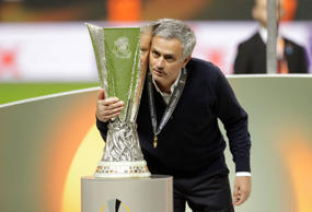 Manchester manager Jose Mourinho poses with the trophy after winning 2-0 during the soccer Europa League final between Ajax Amsterdam and Manchester United at the Friends Arena in Stockholm, Sweden, Wednesday, May 24, 2017.