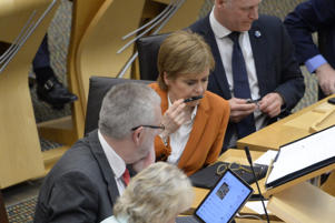 Brexit Minister Michael Russell (L) sits alongside First Minister Nicola Sturgeon as they await the vote at the end of a debate in the Scottish Parliament which refused the Parliament's legislative consent to the UK Government's EU (Withdrawal) Bill, on May 15, 2018 in Edinburgh, Scotland. Under the 'Sewel convention' UK devolved administrations pass legislative consent motions where appropriate agreeing that the UK Parliament can pass legislation on areas of devolved competence.