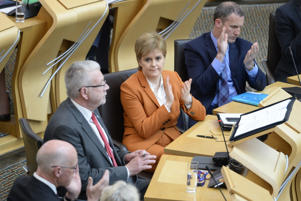 First Minister Nicola Sturgeon applauds Brexit Minister Michael Russell (2nd L) during a debate in the Scottish Parliament which is expected to refuse the Parliament's legislative consent to the UK Government's EU (Withdrawal) Bill, on May 15, 2018 in Edinburgh, Scotland. Under the 'Sewel convention' UK devolved administrations pass legislative consent motions where appropriate agreeing that the UK Parliament can pass legislation on areas of devolved competence.