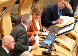 First Minister Nicola Sturgeon with Scottish Brexit Minister Michael Russell during a debate on legislative consent to the EU withdrawal bill at the Scottish Parliament in Edinburgh