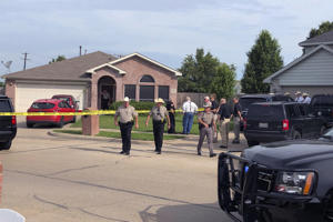 Denton County Sheriff Deputies work the scene of a shooting in Ponder, Texas where multiple people died Wednesday, May 16, 2018 according to Capt. Orlando Hinojosa, a spokesman for the Denton County Sheriff's Office.