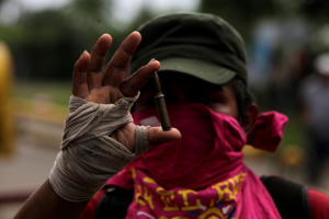 A man shows a casquet bullet during protests in Masaya, some 40km southeast of Managua on May 15, 2018. - Nicaragua's powerful Roman Catholic bishops announced they are engaging in talks to resolve a crisis that has left at least 51 people dead in the wake of a crackdown on anti-government protests, initially over proposed cuts to social security benefits that have since been scrapped. (Photo by INTI OCON / AFP)        (Photo credit should read INTI OCON/AFP/Getty Images)