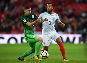LONDON, ENGLAND - OCTOBER 05:  Ryan Bertrand of England and Roman Bezjak of Slovenia battle for the ball during the FIFA 2018 World Cup  Group F Qualifier between England and Slovenia at Wembley Stadium on October 5, 2017 in London, England.  (Photo by Laurence Griffiths/Getty Images)