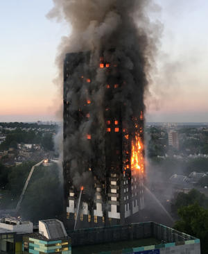 File photo dated 14/06/17 of the fire at Grenfell Tower in west London