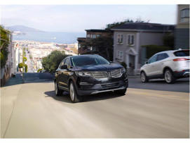 a car parked on the side of a road: 2018 Lincoln MKC