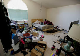 Toys and other items are strewn around one of the bedrooms of a home in Fairfield, Calif., Monday, May 14, 2018, where authorities removed 10 children and charged their father with torture and their mother with neglect after an investigation revealed a lengthy period of severe physical and emotional abuse.