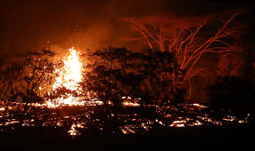 KAPOHO, HI - MAY 17:  Lava erupts from a Kilauea volcano fissure on Hawaii's Big Island on May 17, 2018 in Kapoho, Hawaii. The U.S. Geological Survey said the volcano erupted explosively in the early morning hours today launching a plume about 30,000 feet into the sky.  (Photo by Mario Tama/Getty Images)