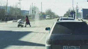 Dust devil chases woman across street in Russia