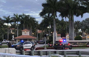 olice respond to The Trump National Doral resort after reports of a shooting inside the resort Friday, May 18, 2018 in Doral, Fla. A man shouting about Donald Trump entered the president's south Florida golf course early Friday, draped a flag over a lobby counter and exchanged fire with police before being arrested, police said. One officer received an unspecified injury, officials said.