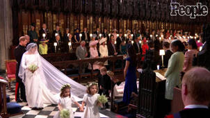 a group of people standing in front of a crowd: Video: All the Times the Kids Stole the Show at the Royal Wedding