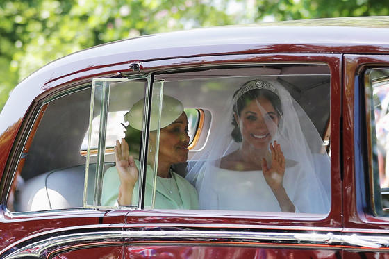 Slide 1 of 100: Meghan Markle and her mother, Doria Ragland, wave to wellwishers as they drive to Windsor Castle for the ceremony.