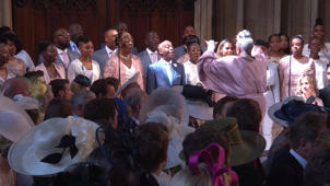 a group of people standing in front of a crowd: Royal Wedding: Hear 'Stand By Me' performed by Karen Gibson and the Kingdom Choir