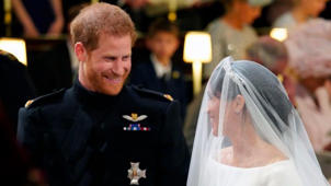 a person posing for the camera: Prince Harry, Meghan Markle exchange vows at royal wedding
