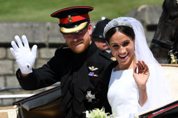 Britain's Prince Harry, Duke of Sussex and his wife Meghan, Duchess of Sussex wave from the Ascot Landau Carriage during their carriage procession on Castle Hill outside Windsor Castle in Windsor, Britain, May 19, 2018. Paul ELLIS/Pool via REUTERS