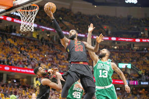 LeBron James #23 of the Cleveland Cavaliers shoots the ball against Marcus Morris #13 of the Boston Celtics in the first half during Game Three of the 2018 NBA Eastern Conference Finals at Quicken Loans Arena on May 19, 2018 in Cleveland, Ohio.