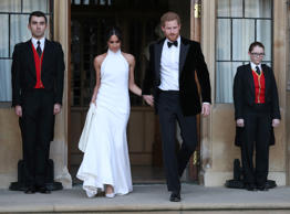 The newly married Duke and Duchess of Sussex, Meghan Markle and Prince Harry, leaving Windsor Castle after their wedding to attend an evening reception at Frogmore House, hosted by the Prince of  Windsor, Britain, May 19, 2018. Steve Parsons/Pool via REUTERS