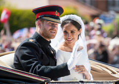 Prince Harry, Duke of Sussex and Meghan, Duchess of Sussex ride by carriage following their wedding at St George's Chapel, Windsor Castle on May 19, 2018 in Windsor, England. Prince Henry Charles Albert David of Wales marries Ms. Meghan Markle in a service at St George's Chapel inside the grounds of Windsor Castle. Among the guests were 2200 members of the public, the royal family and Ms. Markle's Mother Doria Ragland.