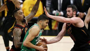 a man standing in front of a crowd: Cavaliers step up on defense in Game 3 victory